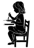 Silhouette girl eats Royalty Free Stock Photo