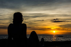 Silhouette girl enjoying herself with Stock Photography