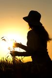 Silhouette of a girl in field with ears Royalty Free Stock Photos