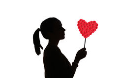 Silhouette girl with flower heart Royalty Free Stock Photography