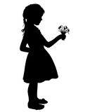 Silhouette girl with flowers Royalty Free Stock Images