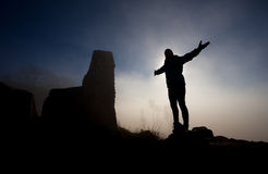 Silhouette of girl in fog in front of ruin Stock Images