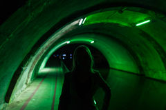 Silhouette of girl in green tunnel. In Metz Royalty Free Stock Photography