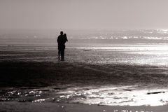 Silhouette of girl and guy West coast of Pacific Ocean Royalty Free Stock Images
