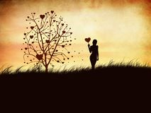Silhouette of a girl with a heart Stock Photos