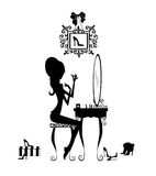 Silhouette of a Girl at her Vanity. Fashion illustration of a pretty girl seated at her vanity applying makeup Stock Image