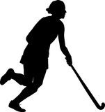 Silhouette of girl hockey player dribbling  ball Stock Image