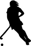 Silhouette of girl hockey player dribbling  ball Royalty Free Stock Photography