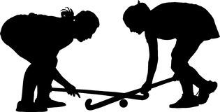 Silhouette of girl hockey players locked in battle  Stock Images