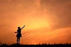 Silhouette girl holding paint brush Royalty Free Stock Photography