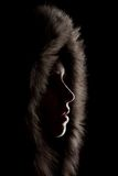 Silhouette of a girl in the hood Stock Photography