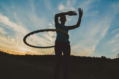 Silhouette of a girl with a hoop Stock Photo