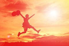 Silhouette a girl jumping Stock Photography