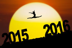Silhouette girl jumping through numbers 2016. Images of silhouette woman celebrate new year of 2016 by jumping through numbers 2016 at sunset time Royalty Free Stock Photo