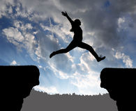 Silhouette the girl jumping over the gap Royalty Free Stock Images