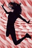 Silhouette Girl Jumping over Red Background Royalty Free Stock Image