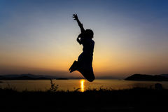 Silhouette of a girl jumping Royalty Free Stock Photos