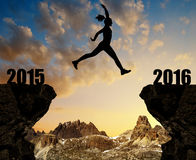 Silhouette the girl jumps to the New Year 2016 Royalty Free Stock Photo