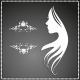 Silhouette of a girl with long hair and beautiful pattern Stock Images