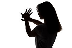 Silhouette of girl making shadows play Royalty Free Stock Photo