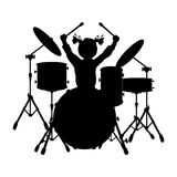 Silhouette girl music plays the drums Stock Image