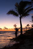 Silhouette of a girl on the ocean at dawn. The Dominican Republic Royalty Free Stock Photography