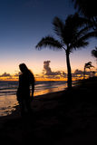 Silhouette of a girl on the ocean at dawn. The Dominican Republic Stock Images