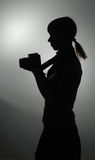 Silhouette of the girl at a photoschool lesson Royalty Free Stock Photos