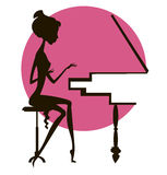 Silhouette of the girl at the piano. Dark silhouette of the girl playing the piano, against a red circle Stock Images