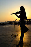 Silhouette of Girl playing the violin Stock Photo