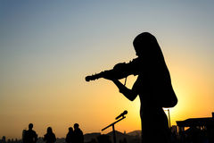 Silhouette of Girl playing the violin stock image