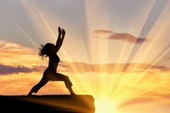 Silhouette of a girl practicing yoga Royalty Free Stock Image