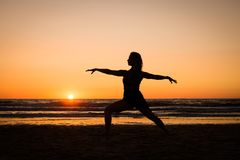 Silhouette of a girl practicing yoga Stock Image