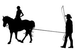 Girl riding on the horse with her trainer. Silhouette of girl riding on the horse with her trainer Stock Photography