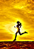 Silhouette of a girl runner effect films royalty free stock photography