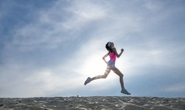 Silhouette of a girl runner effect films stock images