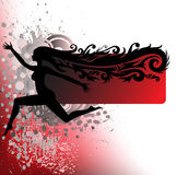Silhouette of a girl running on the spray Stock Photography
