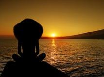 Woman Silhouette Sitting Sunset Beach. Woman silhouette sitting on beach at sunset royalty free stock image