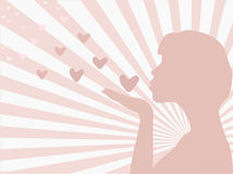 Silhouette of a girl sending love Royalty Free Stock Image