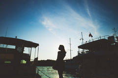 Silhouette girl and ships on the sea Stock Photography