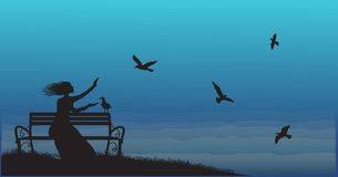Silhouette of girl sitting on the bench near the sea with sun-rise and feed the sea gulls,. Shadows,cold sea morning, memories Stock Photo