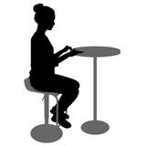 Silhouette girl sitting on a chair white background Royalty Free Stock Image