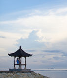 Silhouette of the girl sitting in a yoga posture on the pier Stock Images