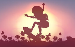 Silhouette girl skateboarding in garden Stock Photo