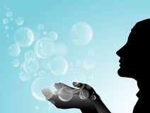 Silhouette of girl with soap bubbles. Stock Photos