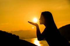 Silhouette of a girl with the sun Stock Image