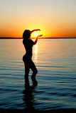 Silhouette of girl on sunset Stock Image