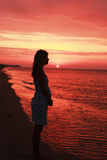 Silhouette of a girl at sunset. A silhouette of a girl at sunset Royalty Free Stock Image