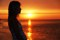 Silhouette of a girl at sunset. A silhouette of a girl at sunset Royalty Free Stock Photography