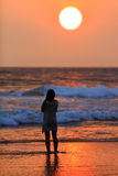 Silhouette of girl on sunset background Royalty Free Stock Photography